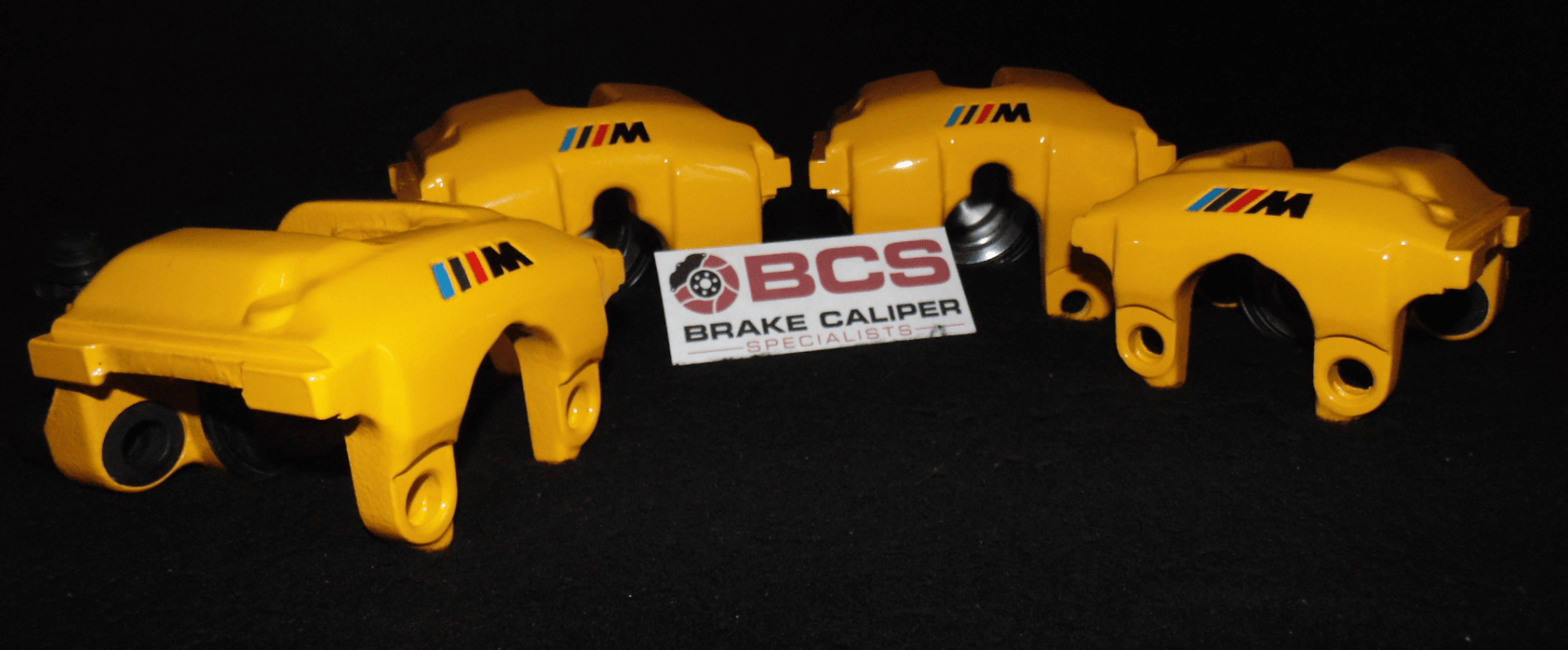 brake calipers painted in yellow with logo's