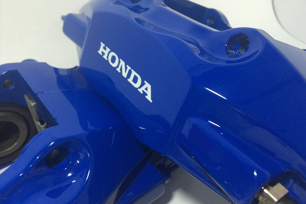 blue Honda brake calipers