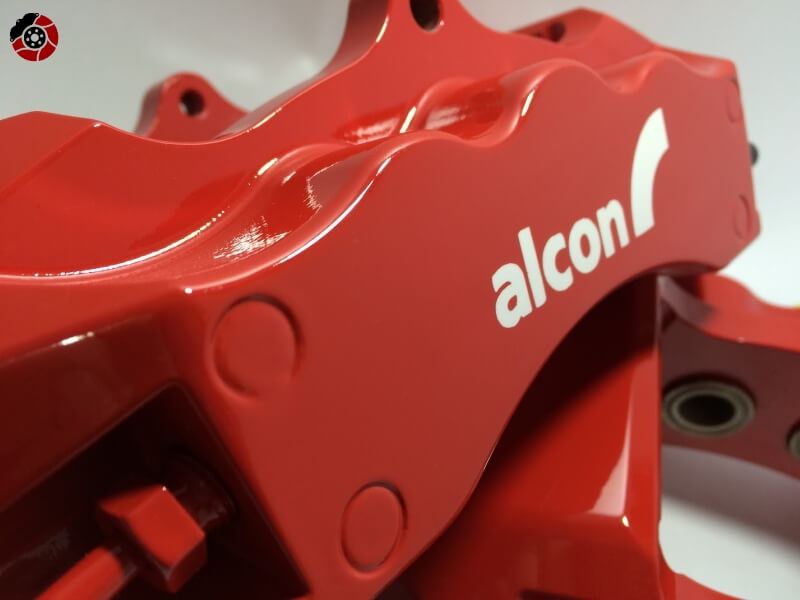 green alcon brake calipers refurbished with logo in cast.