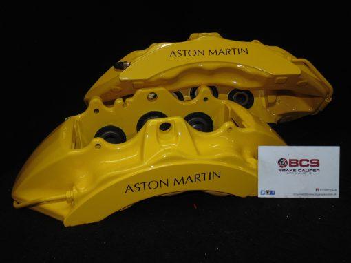 Yellow Aston Martin brake caliper black stencils